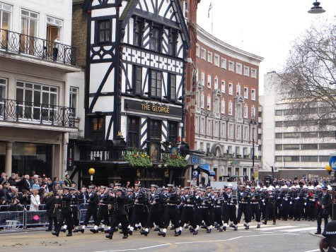Marines in ceremonial uniform marching down Fleet St.