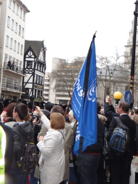 Conservative Party flag amongst the crowd