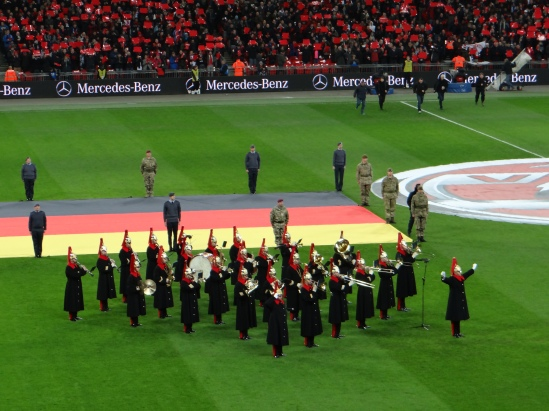 Military band plays German anthem during the England - Germany Game whilst Soldiers hold gigantic flags!