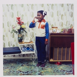 Neil Kenlock, untitled, 1973, A young girl speaking on her parents telephone in South London, 1973. © Neil Kenlock and Victoria and Albert